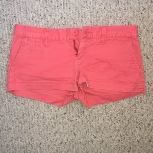 Coral shorts with cute buttons!